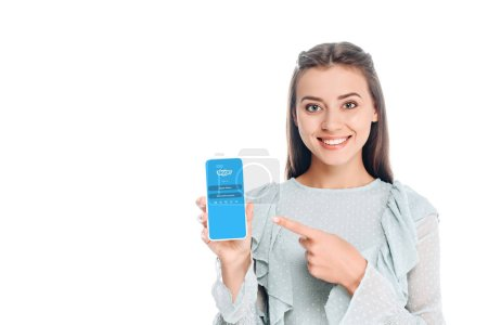 smiling woman showing smartphone with sqype logo on screen isolated on white