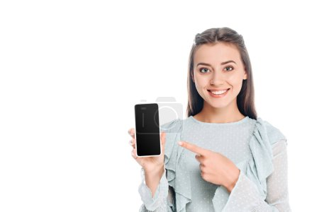 Photo for Portrait of  smiling woman showing smartphone with blank screen isolated on white - Royalty Free Image