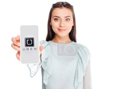 young woman showing smartphone with uber logo on screen isolated on white