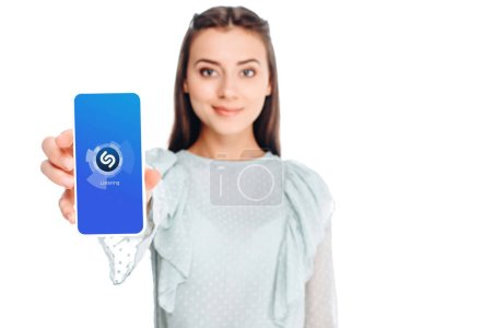 young woman showing smartphone with sqype logo on screen isolated on white