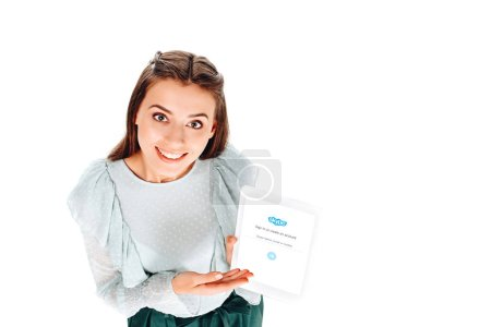 high angle view of smiling woman with tablet with sqype logo on screen isolated on white