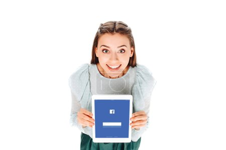 high angle view of smiling woman with tablet with facebook logo on screen isolated on white