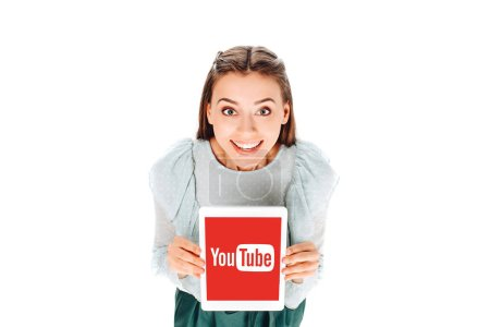 high angle view of smiling woman with tablet with youtube logo on screen isolated on white