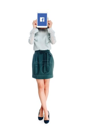 obscured view of woman with tablet with facebook logo on screen isolated on white