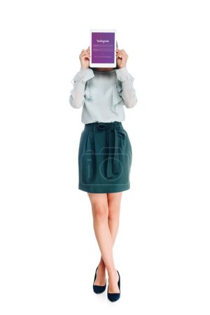 obscured view of woman with tablet with instagram logo on screen isolated on white