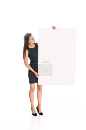 woman in black dress looking  at blank banner in hands isolated on white