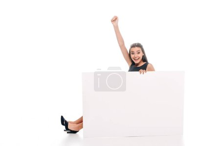 cheerful young woman with blank banner isolated on white