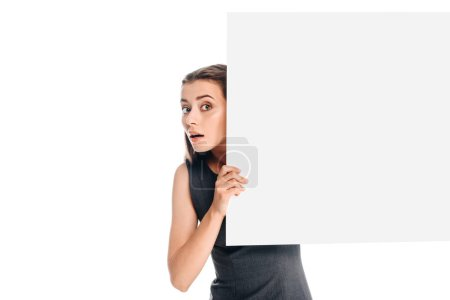 portrait of shocked young woman with blank banner isolated on white