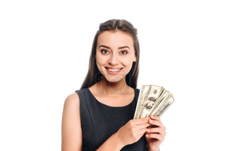 portrait of smiling woman in black dress holding dollar banknotes isolated on white
