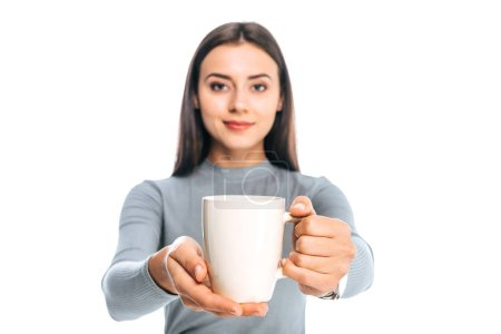 portrait of young woman with cup of coffee isolated on white