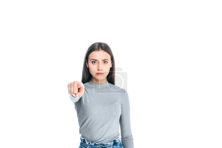 Photo for Portrait of beautiful serious woman pointing at camera isolated on white - Royalty Free Image