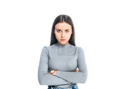 portrait of disappointed woman with arms crossed looking at camera isolated on white