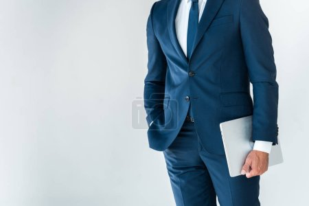 Photo for Midsection of businessman standing with laptop isolated on white - Royalty Free Image