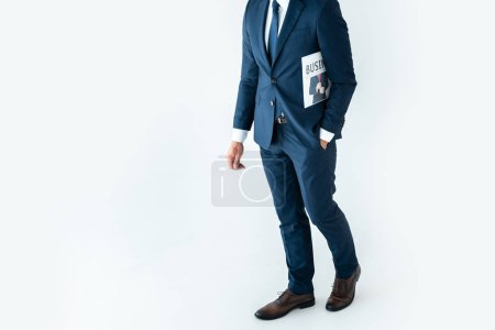 Photo for Cropped image of businessman standing with newspaper isolated on white - Royalty Free Image