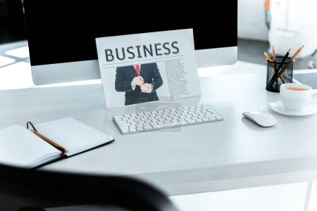 Photo for Selective focus of business newspaper and computer on table in office - Royalty Free Image