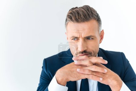 Photo for Portrait of tired handsome businessman looking away isolated on white - Royalty Free Image