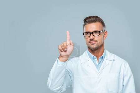 Photo for Handsome scientist in white coat and glasses touching something in air isolated on white, artificial intelligence concept - Royalty Free Image
