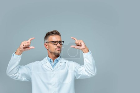 Photo for Handsome scientist in glasses holding something isolated on grey, artificial intelligence concept - Royalty Free Image