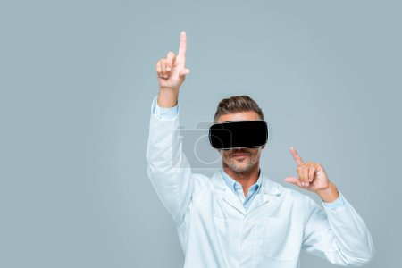 scientist in virtual reality headset touching something isolated on grey, artificial intelligence concept