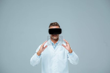 Photo for Scientist in virtual reality headset holding something isolated on grey, artificial intelligence concept - Royalty Free Image