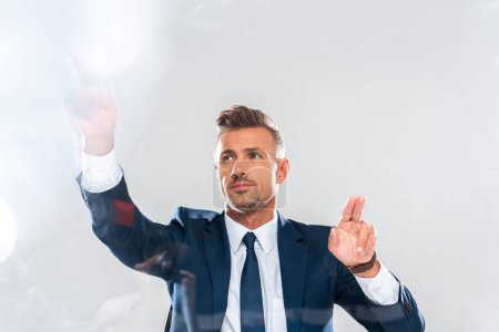 handsome businessman touching something isolated on white, artificial intelligence concept