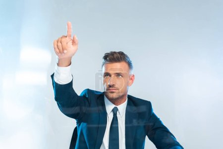 handsome businessman pointing on something isolated on white, artificial intelligence concept