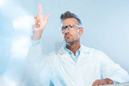 Photo for Handsome scientist in protective glasses touching something isolated on white, artificial intelligence concept - Royalty Free Image