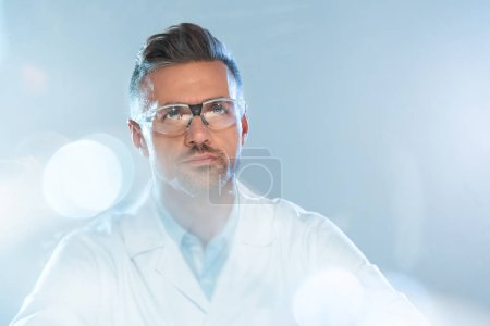 Photo for Portrait of handsome scientist in protective glasses looking up isolated on white, artificial intelligence concept - Royalty Free Image