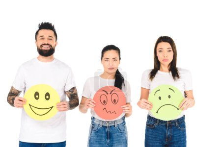 Photo for Group of young people holding colored cards with angry, sad and happy face expressions isolated on white - Royalty Free Image