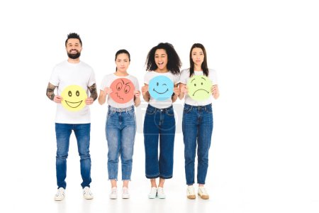 Photo for Multicultural friends in white T-shirts holding round, multicolored signs with different face expressions and looking at camera isolated on white - Royalty Free Image