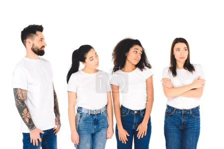 multicultural group of friends looking at sad girl isolated on white