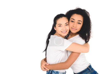 Photo for Multicultural friends hugging and looking at camera isolated on white - Royalty Free Image