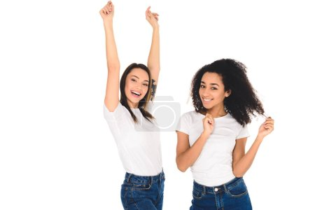 Photo for Multicultural friends in white T-shirts raising hands and looking at camera isolated on white - Royalty Free Image