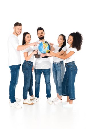 multicultural group of young people pointing with fingers at globe isolated on white