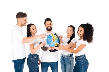 multiethnic group of young people pointing with fingers at globe isolated on white