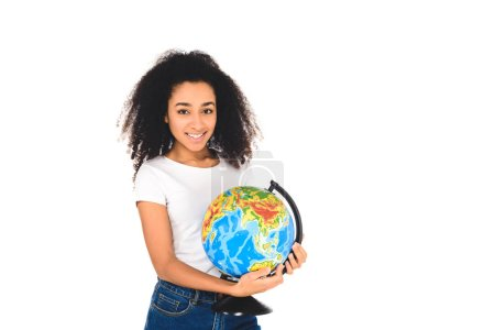 cheerful curly african american girl holding globe isolated on white