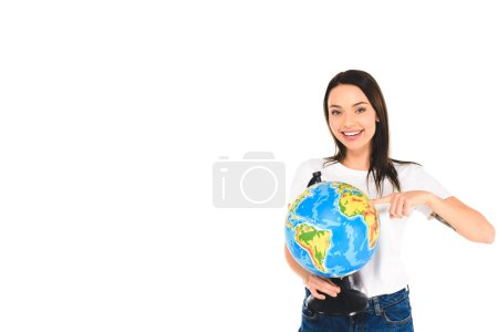 smiling girl pointing with finger at globe isolated on white