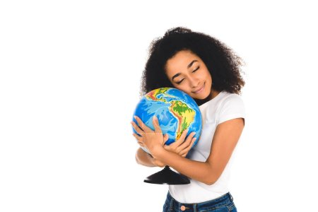 curly african american girl hugging globe isolated on white