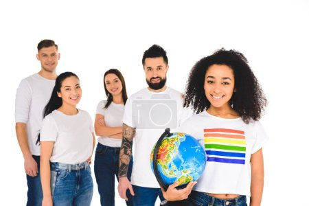 multiethnic group of young people standing behind african american woman with lgbt sign on t-shirt holding globe isolated on white