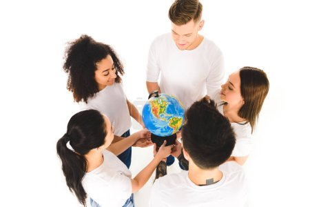 overhead view of multiethnic group holding globe and standing in circle isolated on white