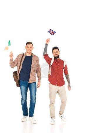 Photo pour Beaux hommes tenant des drapeaux des différents pays isolés sur blanc - image libre de droit
