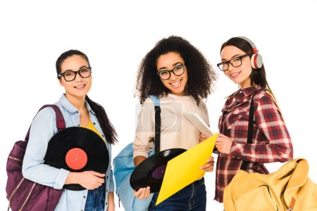 Photo for Attractive girls in glasses with vinyl records and digital tablet isolated on white - Royalty Free Image