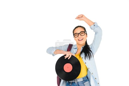 happy girl in glasses holding vinyl record with hand above head isolated on white