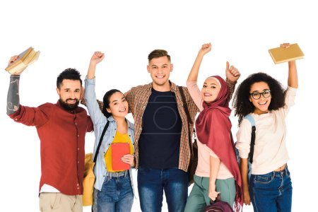 happy multiethnic group of young people holding books above head  isolated on white