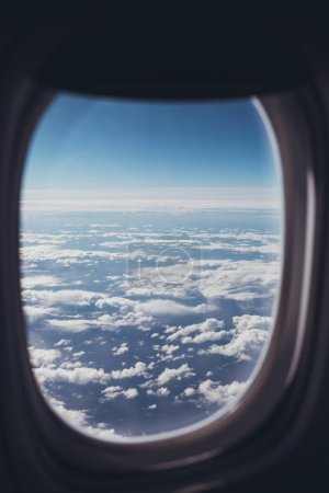 Photo for View of blue cloudy sky from airplane window - Royalty Free Image