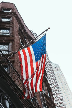 Photo for Close up view of national flag and buildings in new york, usa - Royalty Free Image