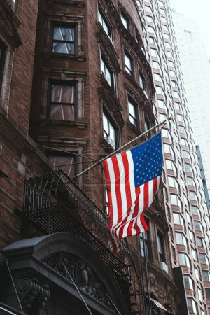 Photo for Urban scene with national american flag on street, new york, usa - Royalty Free Image