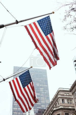 urban scene with national american flags on street, new york, usa