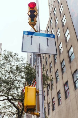 Photo for Urban scene with buildings, traffic light and road sign in new york city, usa - Royalty Free Image