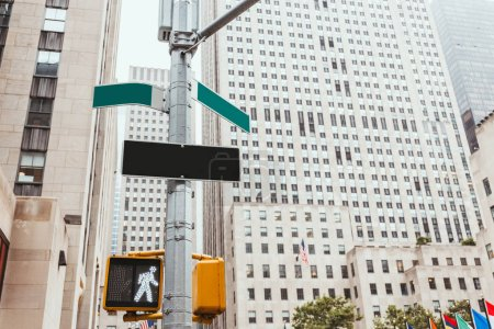 Photo for Urban scene with traffic light, road signs and architecture of new york city, usa - Royalty Free Image